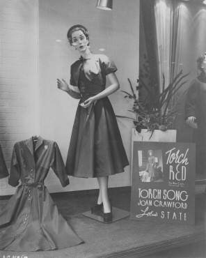 Window display of a 'Torch Red' dress, tying in with 'Torch Song.'