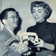 1953. On the set of 'Torch Song' with a Japanese reporter.