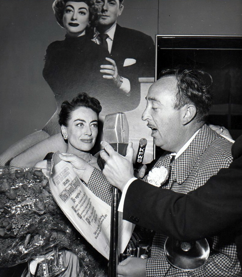 November 1953. Receiving a press photographers' award on the eve of the 'Torch Song' premiere.