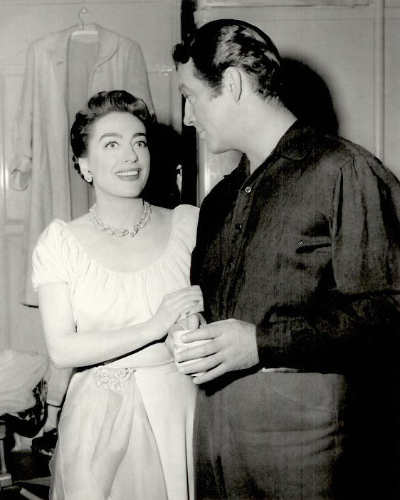 On the set of 'All the Brothers Were Valiant,' with Robert Taylor.