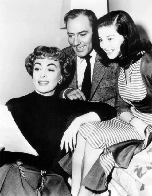 1953. On the set of 'Torch Song.' With Michael Wilding and Pier Angeli.
