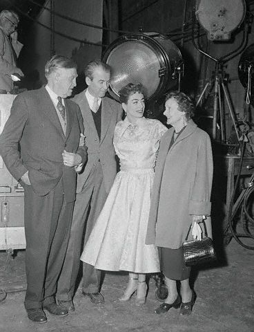 12/31/54. On the 'Female on the Beach' set with James Stewart, his dad, and possibly his mom.