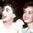 April 1954, with Debbie Reynolds.