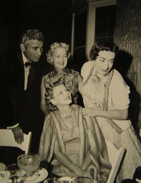 1953. At goddaughter Joan Evans's 1-year wedding anniversary party. With Jeff Chandler.