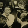 1954. At Chasen's with Kirk Douglas and Donald O'Connor.