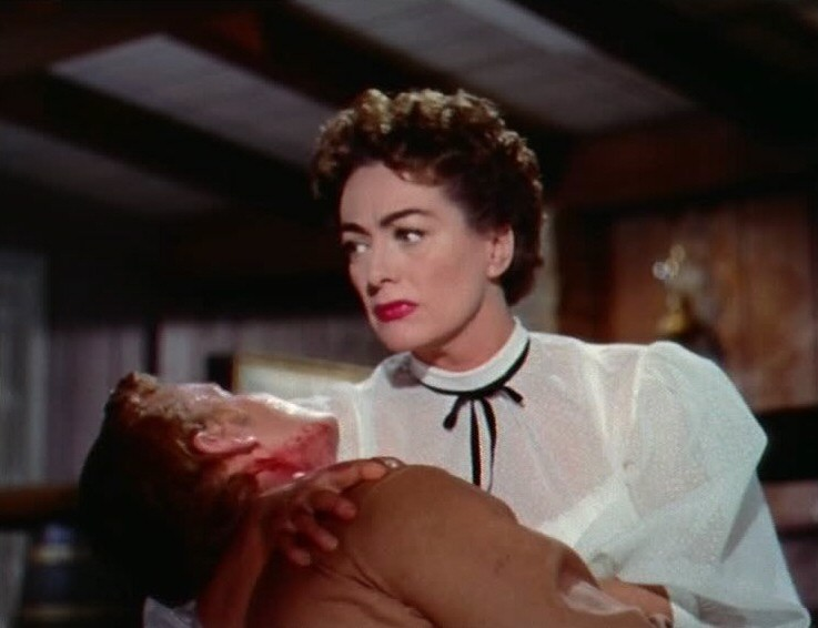 1954. A screen shot from 'Johnny Guitar' with Ben Cooper.