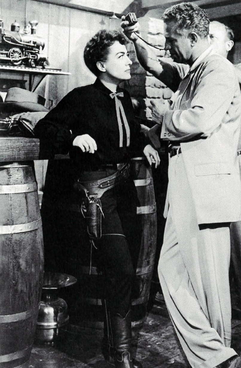 1954. On the set of 'Johnny Guitar' with director Nicholas Ray.