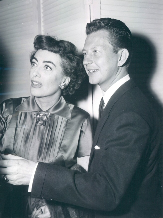 May 1954, with Donald O'Connor at the Beverly Hills Hotel.