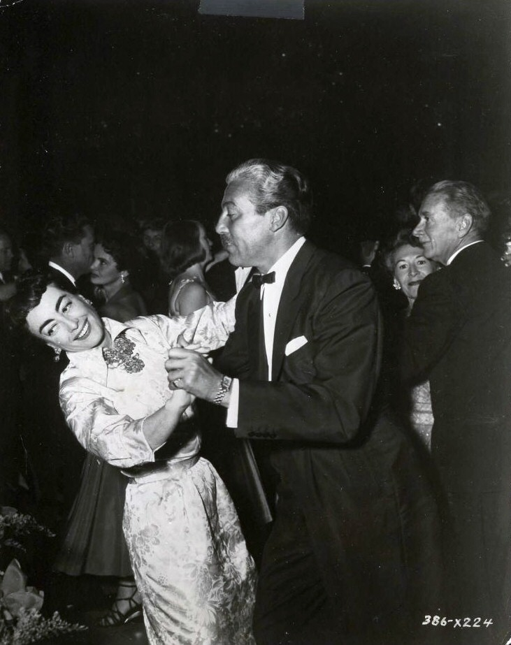At the 9/29/54 premiere of 'The Star Is Born' with Cesar Romero.