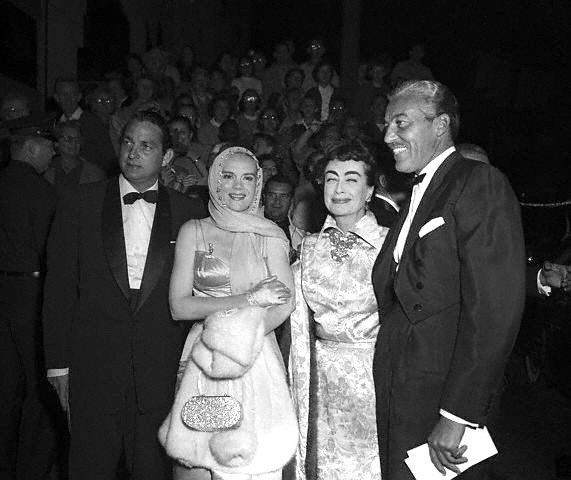 1954 'Star is Born' premiere, with unknown man, Marie Wilson, and Cesar Romero.