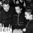January 13, 1955. The twins celebrate their 8th birthday on the 'Female on the Beach' set.