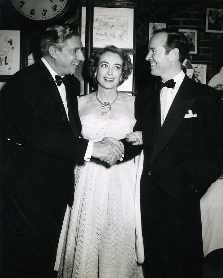 1952. With Earl Blackwell, right.