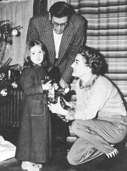 Christmas Eve, 1955. With writer Paul Gallico and daughter.