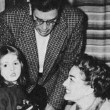 New Year's Eve, 1955. Joan throws a party for writer Paul Gallico, pictured here with his daughter.