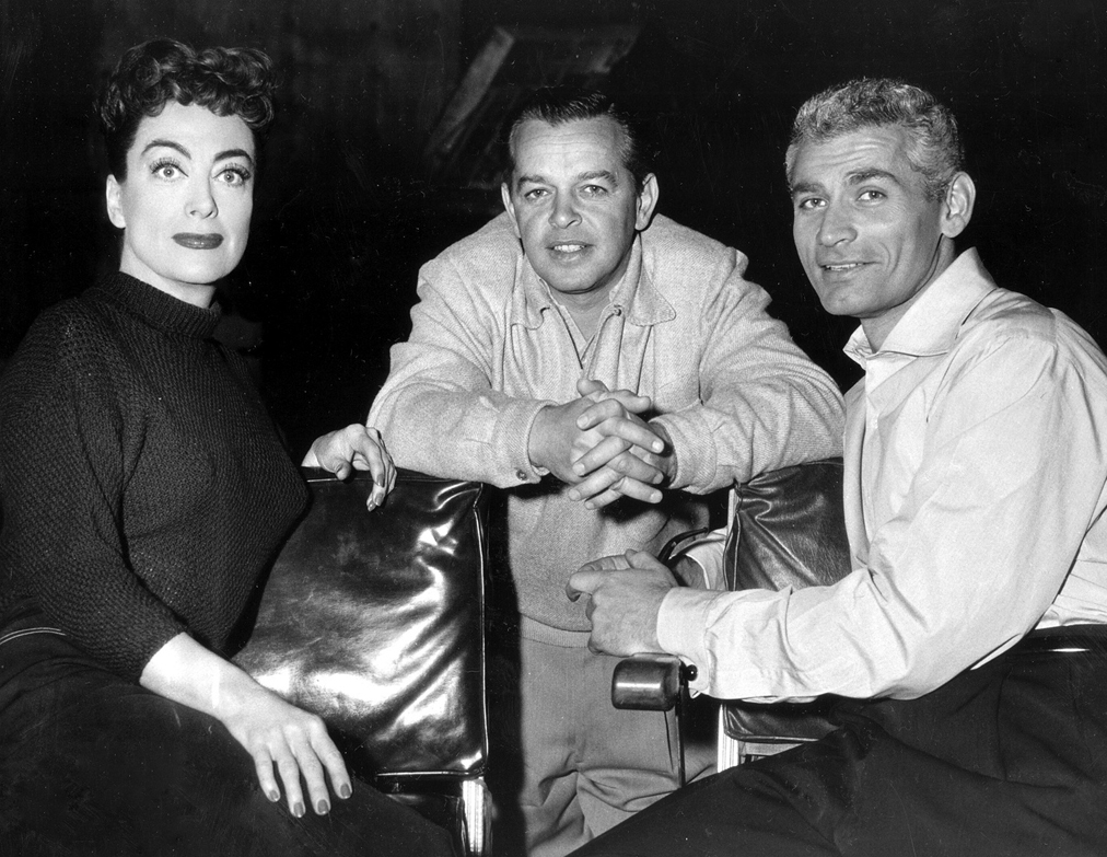 1955. On the set of 'Female on the Beach' with director Joseph Pevney and Jeff Chandler.