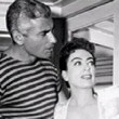1955. On the set of 'Female on the Beach' with Jeff Chandler.