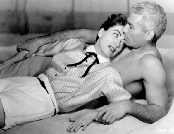 1955. Publicity from 'Female on the Beach.' With Jeff Chandler. (Thanks to Shane.)