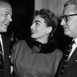 May 1955 at a Columbia party honoring Joan. With exec, left, and husband Al Steele. (Includes press caption.)
