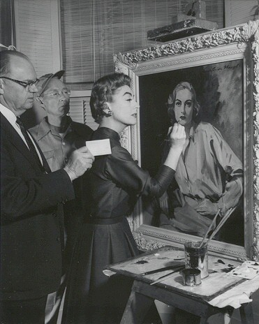 1955. Joan with the Haupt painting on the 'Queen Bee' set.