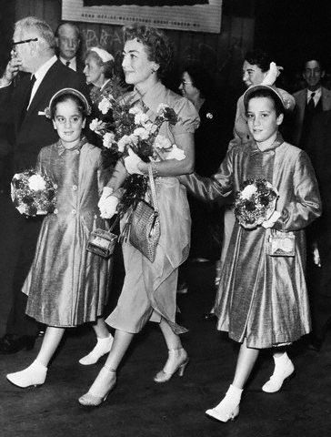 August 1956. Twins arrive in London.