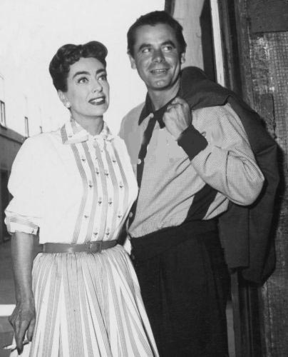 1956. On the set of 'Autumn Leaves' with old flame Glenn Ford.