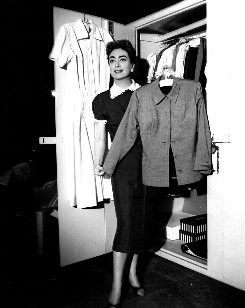 On the set of 'Autumn Leaves' with wardrobe.