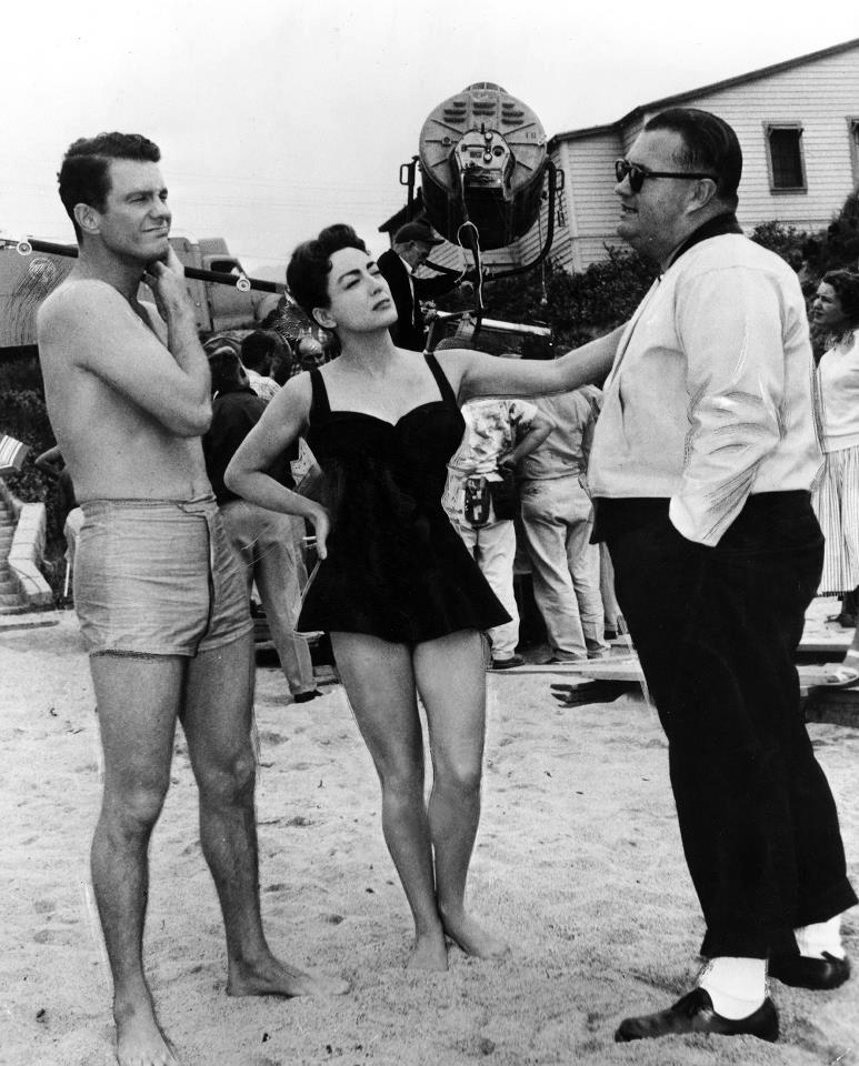 1956. On the set of 'Autumn Leaves' with Cliff Robertson and director Robert Aldrich. (Thanks to Crystal.)