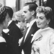 October 29, 1956. Being presented to the Queen at the Empire Theatre.