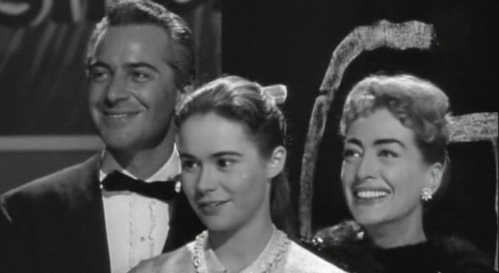 1957. 'The Story of Esther Costello' screen shot with Rossano Brazzi and Heather Sears.