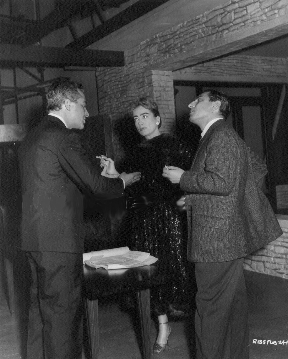 1957. On the set of 'Esther Costello' with Rossano Brazzi and director David Miller.