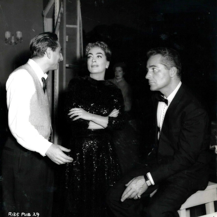 1957. On the set of 'Esther Costello' with director Miller (left) and co-star Brazzi.
