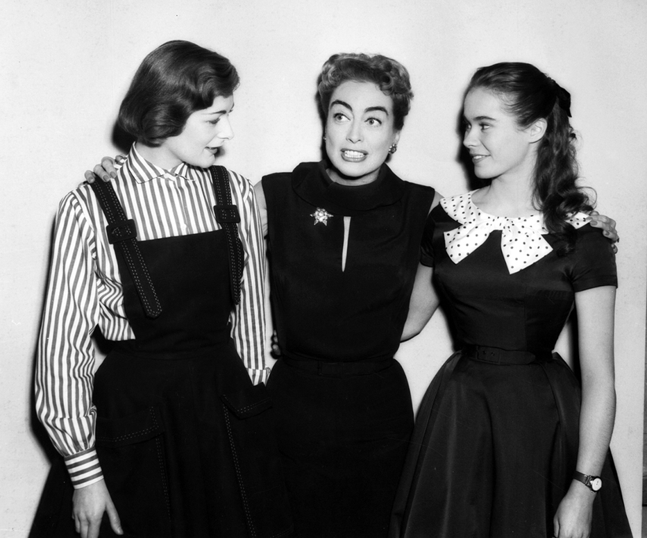 1957. On the set of 'Esther Costello' with Heather Sears, right, and Sears' sister. (Thanks to Vincent.)