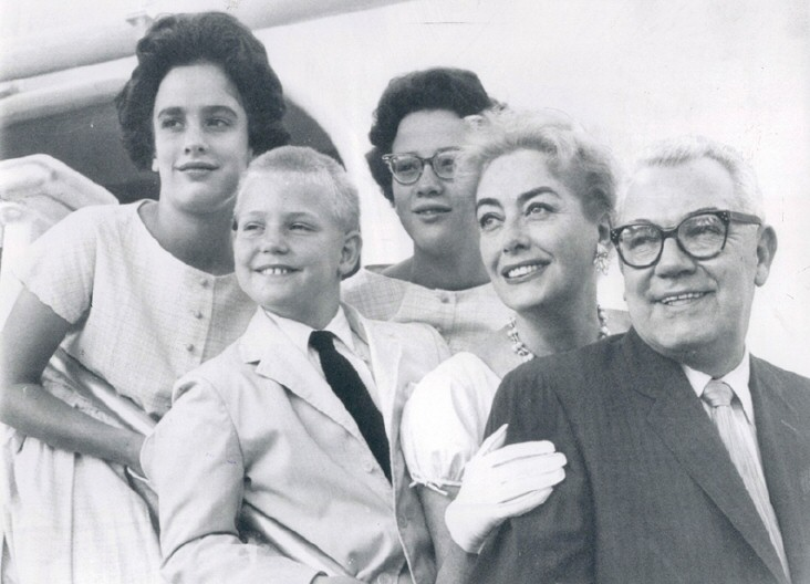 August 6, 1958. Back in America aboard the USS United States. With twins, Al, and Al's son Sonny.