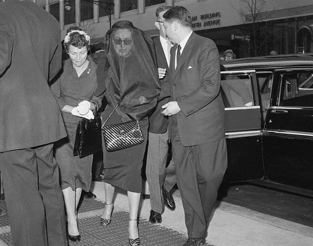 April 22, 1959. Arriving for Al Steele's funeral, with his daughter Sally.