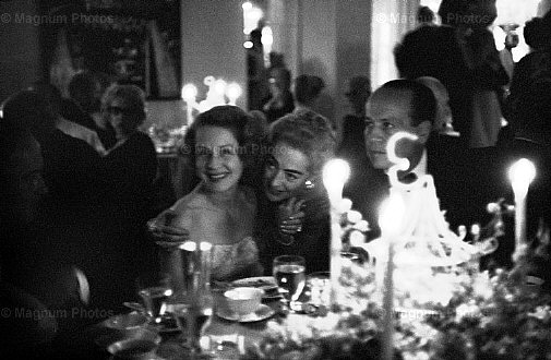 1959. Joan with Norma Shearer and producer Jerry Wald in Hollywood.