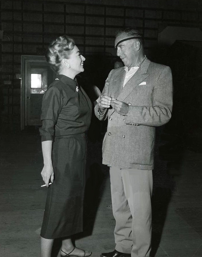 Director Raoul Walsh visits the 'Best of Everything' set.