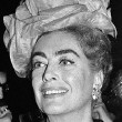 January 10, 1960. Joan receives one of 7 'Golden Hat Awards' given by the Millinery Institute of America.