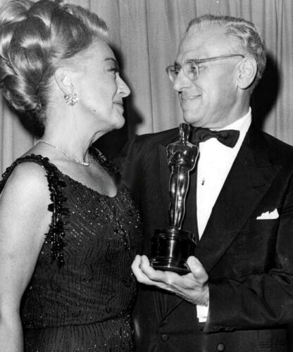 At the 4/5/65 Academy Awards with Best Director George Cukor.