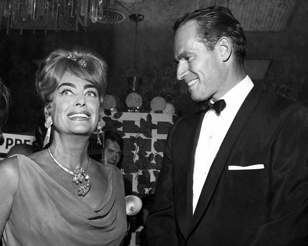 July 1962. At the Golden Globes banquet at the Beverly Hilton, with Charlton Heston.
