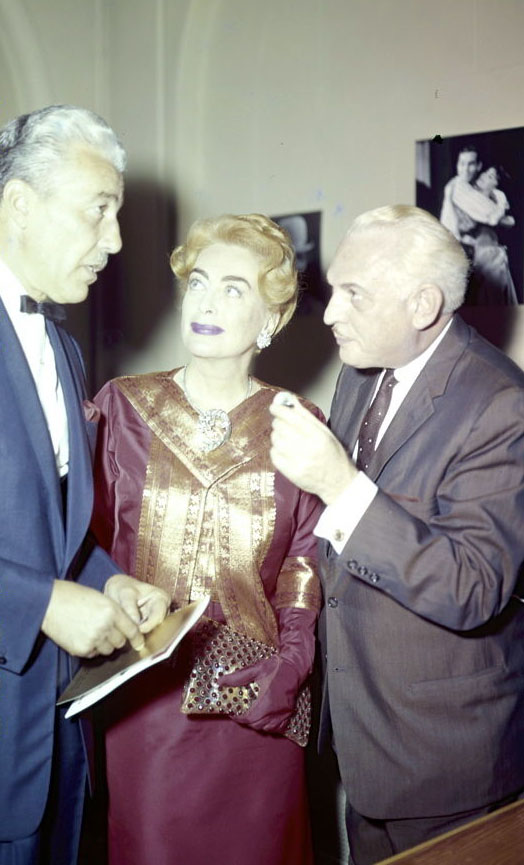 1961 candid with Cesar Romero.