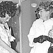 November 1960. (That might be radio host Shirley Eder with Joan.)