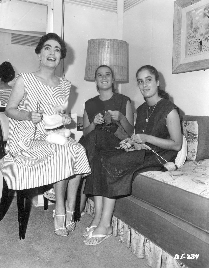 1962. On the set of 'Baby Jane' with twins Cathy and Cindy.