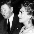 1962. At a Hollywood party in her honor. With Herbert Marshall and wife. (Includes press caption.)
