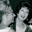 July 1962. Joan and Rosalind Russell at the Beverly Hilton for the Golden Globes awards banquet. (Includes press caption.)