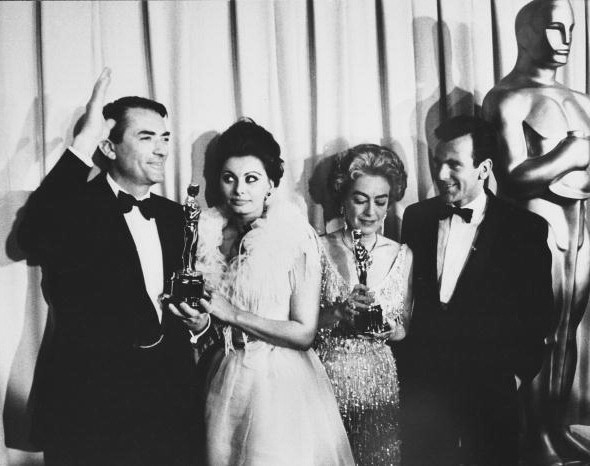At the 4/8/63 Academy Awards with Gregory Peck, Sophia Loren, and Maximilian Schell. (Thanks to Bryan.)