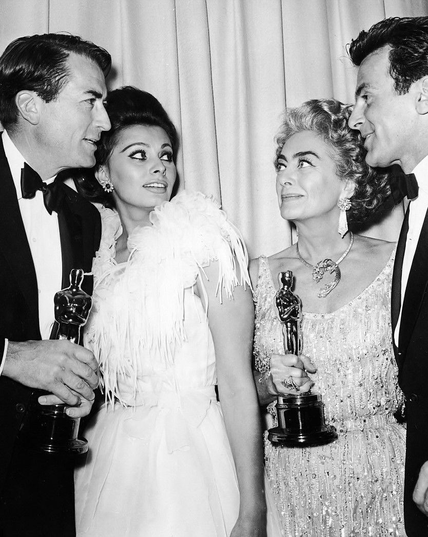 At the 4/8/63 Oscars with Gregory Peck, Sophia Loren, and Maximilian Schell.