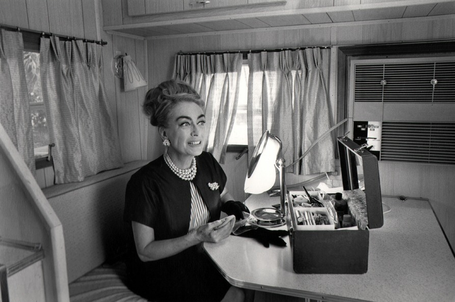 1964. In her trailer on the set of 'Hush...Hush Sweet Charlotte.' Photo by Flip Schulke.