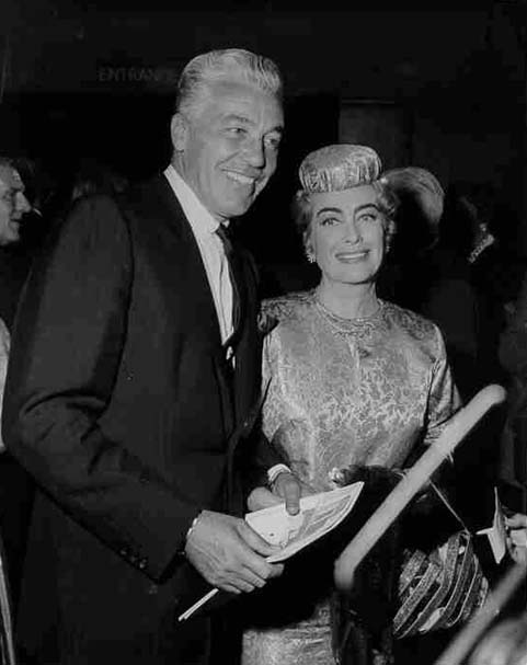 Circa 1964. Joan with Cesar Romero.