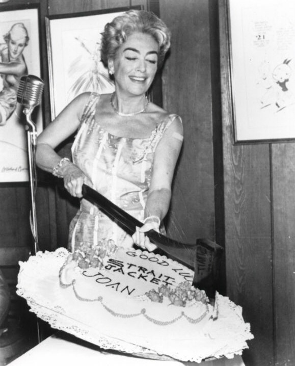 1963. A cake at the beginning of filming for 'Strait-Jacket.'