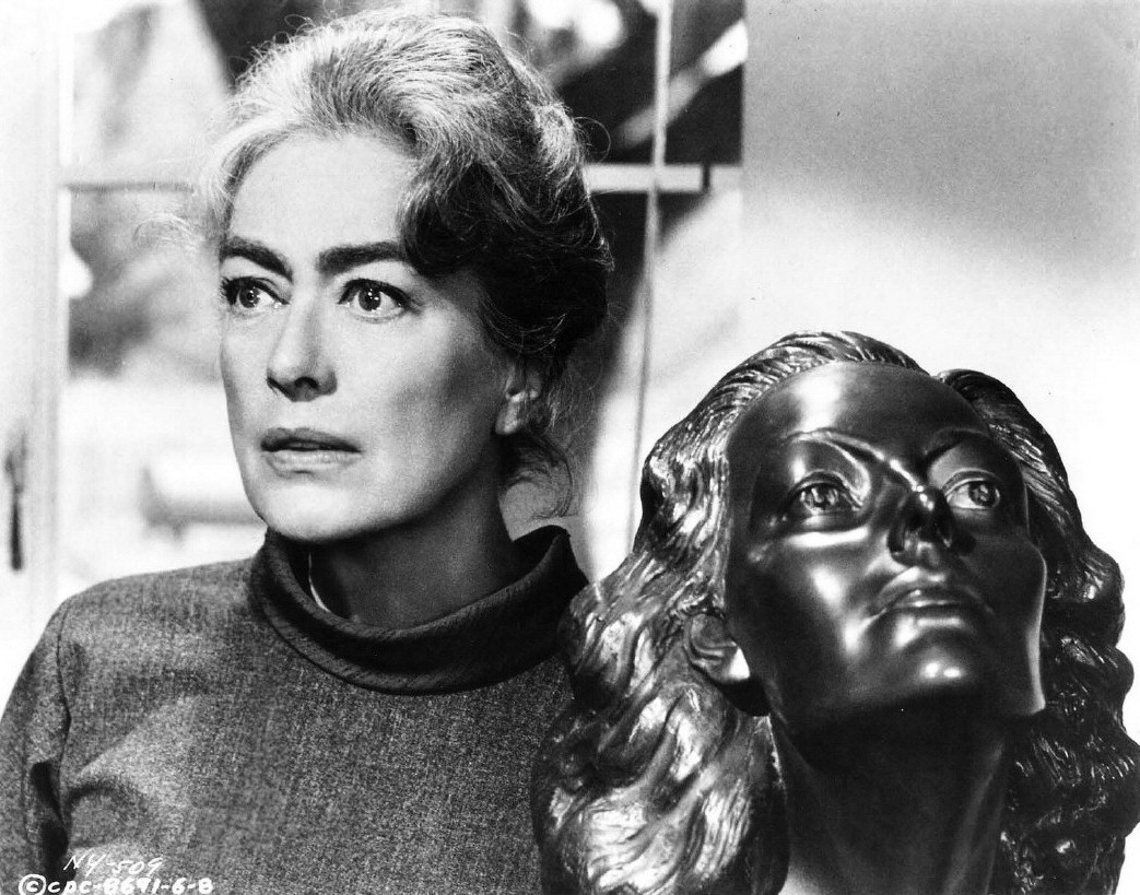 1964. 'Strait-Jacket.' With a sculpture of herself given to her in 1941 by Yucca Salamunich.